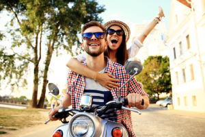 Couple-in-love-riding-a-motorbike-Handsome-guy-and-young-sexy-woman-travel-.-Young-riders-enjoying-themselves-on-trip.-Adventure-and-vacations-concept
